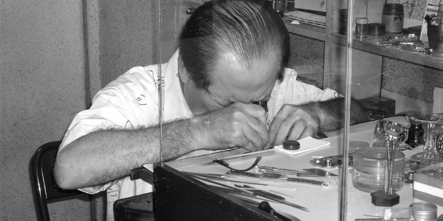 Man fixing watch, Malaysia