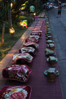 Row of rice baskets and stools