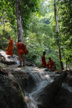 Monks on their way to the top pool