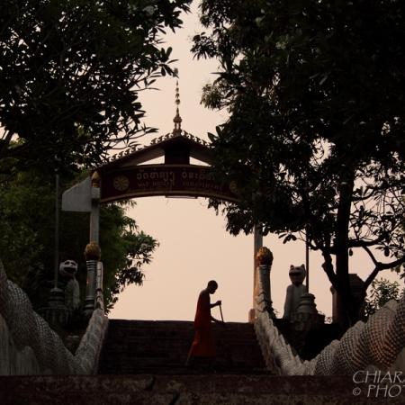 Morning chores at the temple. Luang Prabang, Laos