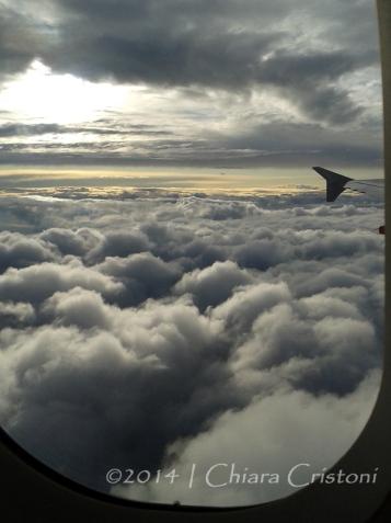 fluffy clouds plane flight window scenery