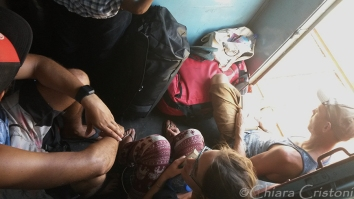 Other backpackers sitting on the floor