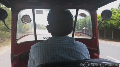 Sitting in the back of a tuk tuk